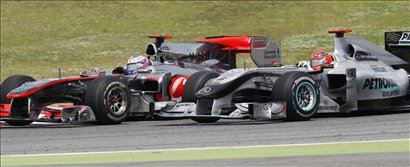 Jenson Button in Michael Schumacher