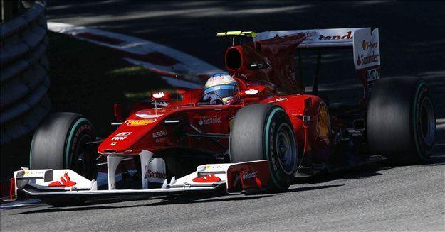 Zmagovalec dirke formule ena za veliko nagrado Italije v Monzi je Španec Fernando Alonso (Ferrari). Na stopničkah še Jenson Button (McLaren) in Felipe Massa (Ferrari).